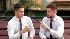 Two businessmen on a break stock video