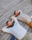 A two businessmen in a break between work. He relaxes looking into the sky Royalty Free Stock Images