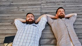 A two businessmen in a break between work. He relaxes looking into the sky Stock Photos