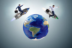 The two businessmen chasing around globe Stock Image