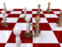 Two businessmen on chessboard shake hands Stock Photography