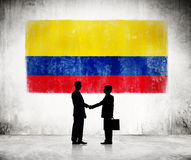 Two Businessmen with Colombian Flag Royalty Free Stock Images
