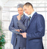 Two businessmen conclude. A deal royalty free stock image