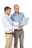 Two businessmen consulting a laptop Stock Photos