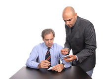 Two businessmen at desk Stock Photos