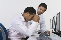 Two Businessmen At Desk In Front Of Computer Stock Photos