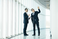 Two businessmen dicussing building changing Royalty Free Stock Image