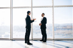 Two businessmen dicussing business perspectives Stock Photos