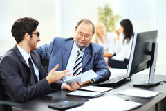 Two businessmen discuss the company`s financial plan Royalty Free Stock Images