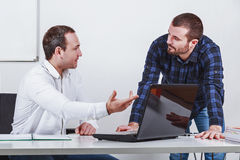 Two businessmen  discuss at meeting in office. Two businessmen in office  discussing at meeting in office Stock Image