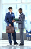 Two businessmen discussing Royalty Free Stock Photo