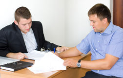 Two businessmen discussing a contract Stock Photography