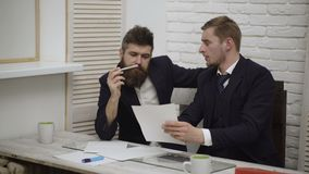 Two businessmen discussing at office during business meeting. Businessmen discussion standing clipboard concept. Two. Young business collegues working together stock video