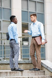 Two businessmen discussing  project Stock Photos