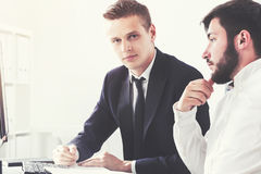Two businessmen discussing stuff in office Royalty Free Stock Photos