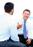Two businessmen discussing tasks sitting Royalty Free Stock Image