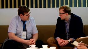 Two businessmen discussing at Velocongress at Tekhnopolis Hall stock video footage