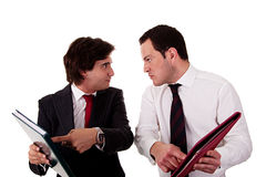 Two businessmen discussing because of work, pointi Stock Photography