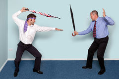 Two businessmen fighting Royalty Free Stock Photo