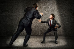 Two businessmen fighting as sumoist Stock Images