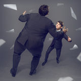 Two businessmen fighting as sumoist Stock Image