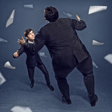 Two businessmen fighting as sumoist Stock Photos