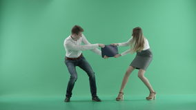 Two businessmen fighting on a green screen. Two businessmen fighting for work on a green screen stock footage