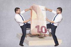 Two businessmen fighting for money Royalty Free Stock Photo