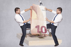 Two businessmen fighting over money Royalty Free Stock Photo