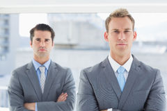 Two businessmen frowning at camera Royalty Free Stock Images
