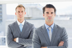 Two businessmen frowning at camera Royalty Free Stock Photos