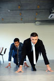 Two businessmen getting ready for corporate race Royalty Free Stock Photo
