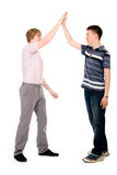Two businessmen give each other a high five Stock Photography