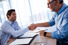 Two businessmen giving a handshake Stock Images