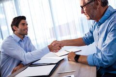 Two businessmen giving a handshake Royalty Free Stock Image