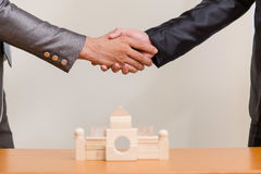Two businessmen hands in elegant suits handshake Royalty Free Stock Photos