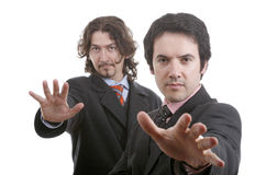 Two businessmen hands out. Portrait of two businessmen with hands reaching out Royalty Free Stock Image