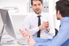 Free Two Businessmen Having Discussion In Office Stock Photos - 46238443