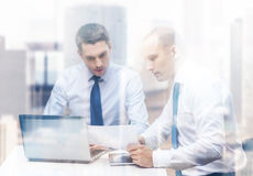 Two businessmen having discussion in office Stock Images