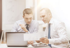 Two businessmen having discussion in office Stock Photos