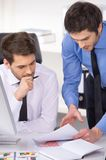 Two businessmen having discussion in office. Royalty Free Stock Photography