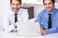Two businessmen having discussion in office. Royalty Free Stock Photo