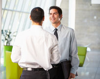 Two Businessmen Having Informal Meeting In Modern Office Stock Photography
