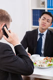 Two businessmen having a lunch time. Vertical Royalty Free Stock Photography