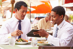 Two Businessmen Having Meeting In Outdoor Restaurant Royalty Free Stock Photo