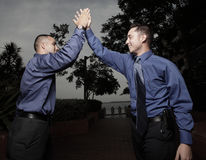 Two businessmen high fiving each other Stock Images