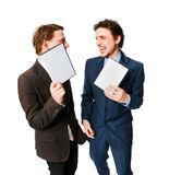 Two businessmen holding DVDs Royalty Free Stock Photography