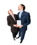 Two businessmen holding DVDs Stock Image