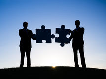 Two Businessmen Holding the Puzzle Stock Photo