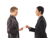 Two businessmen holding a visit card Stock Image